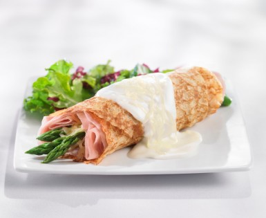 Crepes filled with ham, emmenthal cheese and asparagus