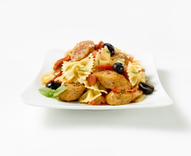 Pasta sauteed with sausage and tapenade