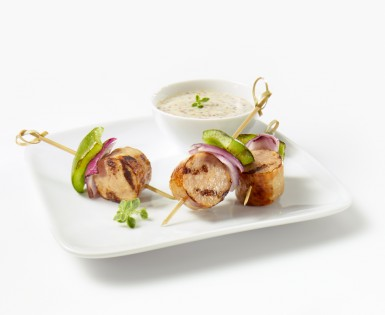 German sausages mini-brochettes with mustard, honey and yogurt dip
