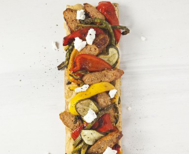 Puff pastry with hummus, vegetables, Italian sausage and  fresh goat cheese