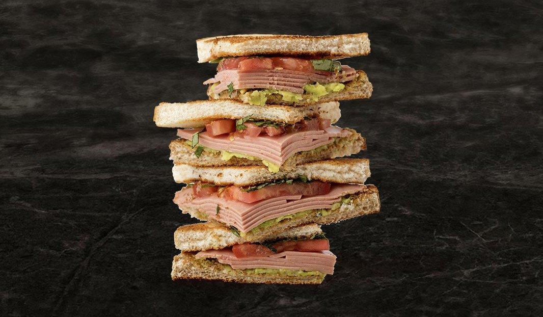Tomato, mock chicken and avocado sandwich